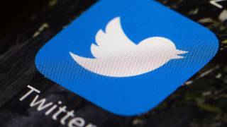 The Twitter app icon on a mobile phone.