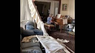 Elderly lady plays piano in damaged Beirut apartment