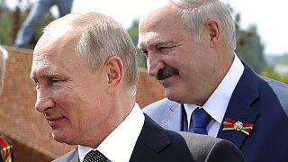 In this June 30, 2020 file photo, Russian President Vladimir Putin, left, and Belarusian President Alexander Lukashenko greet WWII veterans, in Khoroshevo,Russia