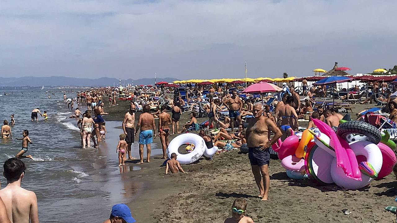 People enjoy the beach in Fregene, a fashionable sea resort some 30km (19 miles) north of Rome, Sunday, July 26, 2020.