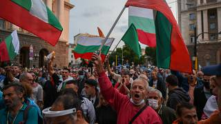 Protesters shout slogans and wave Bulgarian flags during an anti-government demo in Sofia, on August 5, 2020