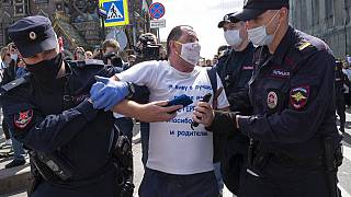 Police detain a protester during a rally supporting Khabarovsk region's governor Sergei Furgal in St.Petersburg, Russia, Saturday, Aug. 1, 2020