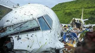 Fierce rain and winds lashed a plane carrying 190 people before it crash-landed and tore in two.