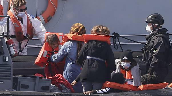 A Border Force vessel brings a group of people thought to be migrants into the port city of Dover.