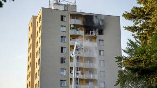 Firefighters battle a fire in an apartment building in Bohumin, northeastern Czech Republic, on Saturday, Aug. 8, 2020