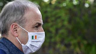Ireland's Prime Minister Micheal Martin arrives at the European Council building for an EU summit in Brussels, Sunday, July 19, 2020