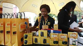 Staff of MTN work during the launch of mobile number portability in Lagos, Nigeria