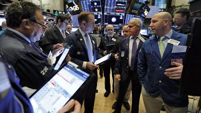 Stock market traders investing your money.