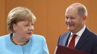 Olaf Scholz (right) has been serving as minister of finance and vice chancellor under Angela Merkel (left) since March 2018