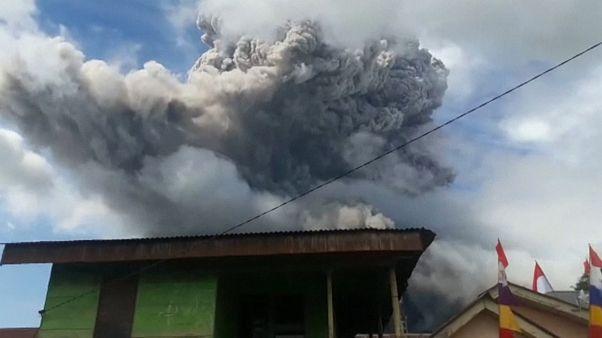 Black smoke rising from Mount Sinabung