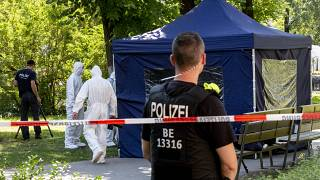 This photo taken on August 23, 2019 shows police forensic experts in a Berlin park where a man of Georgian origin was shot dead.
