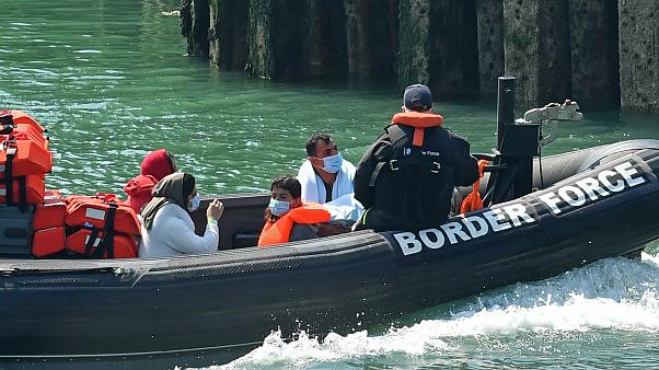A UK Border Patrol dinghy brings a group of migrants, believed to have been picked up from boats in the Channel, into harbour at the port of Dover, England, August 9, 2020.