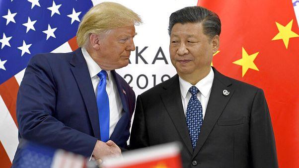 ABD Devlet Başkanı Donald Trump (solda), Çin Devlet Başkanı Şi Jingpin (sağda)