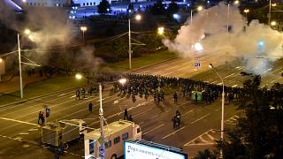 Police block a square during a mass protest following the presidential election in Minsk, Belarus