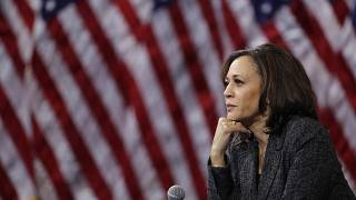 FILE - In this June 2019 photo, then-Democratic presidential candidate Sen. Kamala Harris, D-Calif., listens to questions after the Democratic primary debate in Miami