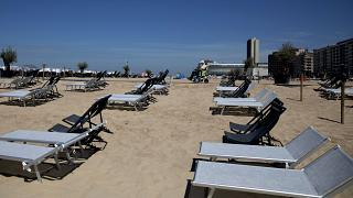 Belgium's interior minister has stepped into defend free movement after several towns imposed beach bans on day trippers
