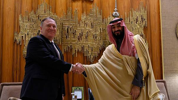 Mike Pompeo,shakes hands with bin Salman