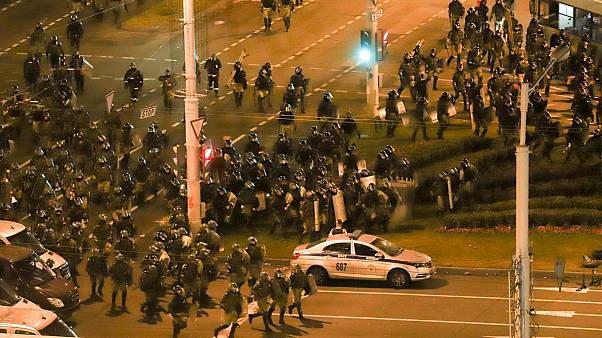 Police move to block demonstrators during a mass rally following the presidential election in Minsk, Belarus,