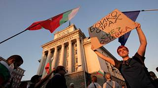 "Protesters carry a poster reading ""Borissov, I am not afraid, but you are! Resignation"" (in Bulgarian) during a mass protest in downtown Sofia, Bulgaria, on July 29."