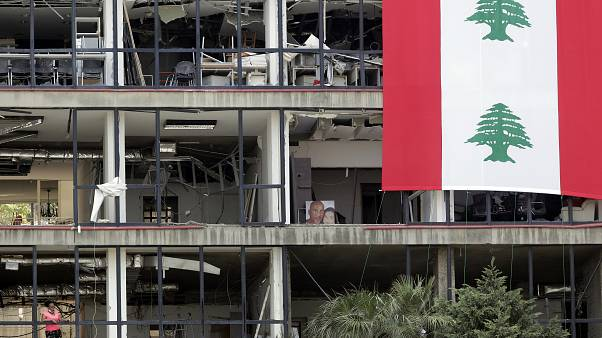 A picture of victims is displayed inside their damaged apartment facing the port of Beirut.