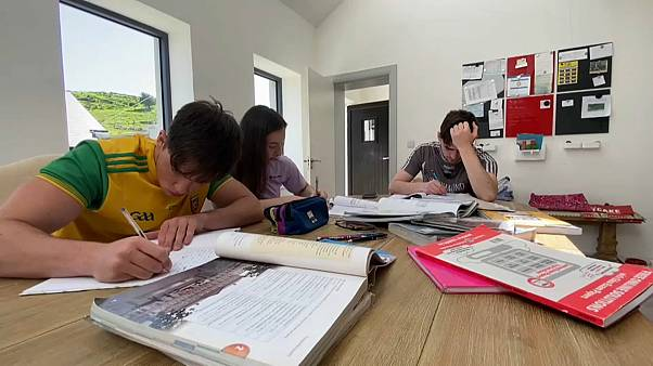 A group of students takes notes