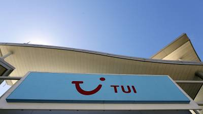 The sign above a branch of a Tui store in London, Thursday, July 30, 2020.