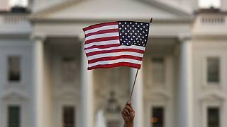 A flag is waved outside the White House, in Washington