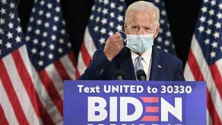 Democratic presidential candidate, former Vice President Joe Biden takes off his mask