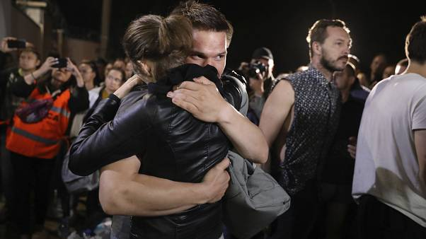 A couple hug after being released from a detention centre where protesters were detained during a mass rally following the presidential election in Minsk, Belarus. August 14