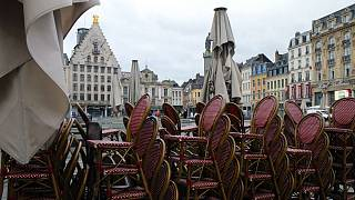 Chairs are stacked up outside an empty restaurant in the center of Lille, northern France