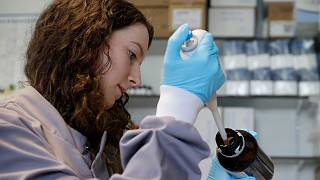 Jess O'Hara a research technician works on the process of testing antibodies to see if they bind to the virus, in the laboratory at Imperial College in London, July 30, 2020