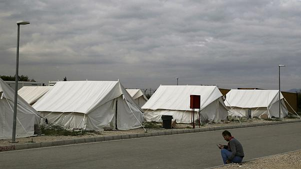 A migrant from Syria rests at a refugee camp in Kokkinotrimithia outside of Nicosia, Cyprus