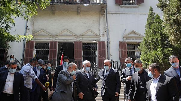 Iranian FM Zarif outside the Lebanese FM which damaged by last week's explosion