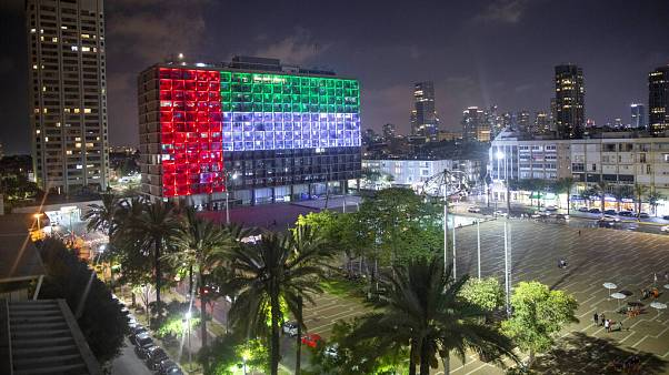 """Tel Aviv City Hall is lit up with the flags of the United Arab Emirates after Prime Minister Benjamin Netanyahu announced the """"full and official peace"""" on TV"""