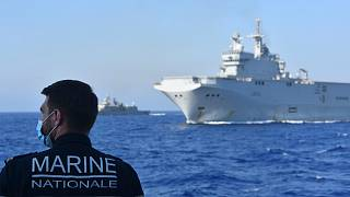 French Tonnerre helicopter carrier escorted by Greek and French military vessels during a maritime exercise in the Eastern Mediterranean.