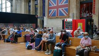 Passengers wait next to the Eurostar Terminal at the Gare du Nord train station in Paris