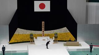 Japanese Prime Minister Abe bows to Emperor Naruhito during the ceremony marking 75 years since WW2