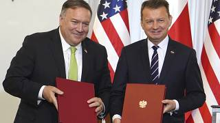 US Secretary of State Mike Pompeo, left, and Poland's Minister of Defence Mariusz Blaszczak after signing a defence cooperation deal.