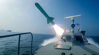 In this photo released Tuesday, July 28, 2020, by Sepahnews, a Revolutionary Guard's speed boat fires a missile during a military exercise.
