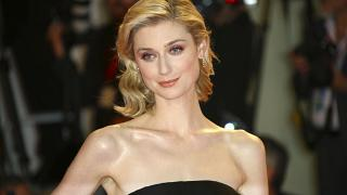 Actress Elizabeth Debicki poses for photographers at the premiere of 'The Burnt Orange Heresy' in Venice, Italy, Sept. 7, 2019