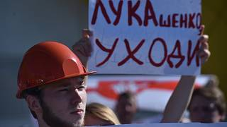"Workers of Minskenergo (Minsk Energy Company) hold a poster reading ""Lukashenko go away!"" during the rally in Minsk, on August 17, 2020,"