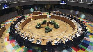 In this Feb. 21, 2020 file photo, European Union leaders meet at a round table during an EU summit in Brussels.