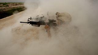 Afganistan'ın Helmand kentinde Taliban militanlarıyla savaşan ABD askerleri (arşiv)