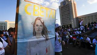 People carry a portrait of Sviatlana Tsikhanouskaya, former candidate for the presidential elections during an opposition rally.