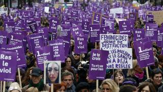Women hold placards as they march against domestic violence, in Paris, Saturday, Nov, 23, 2019.
