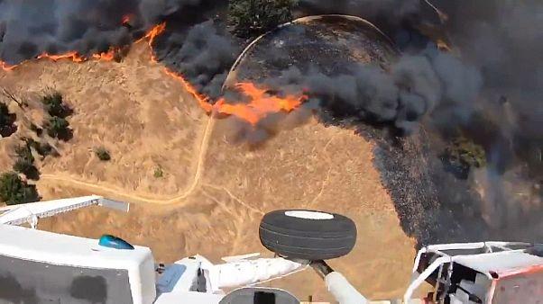 Helicopter dumps water on Malibu's Rock Pool Fire