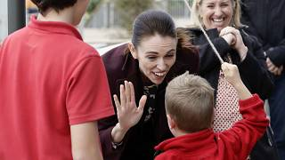 New Zealand Prime Minister Jacinda Ardern gestures with a student during the opening ceremony for Redcliffs School in Christchurch, New Zealand, Thursday, June 25, 2020