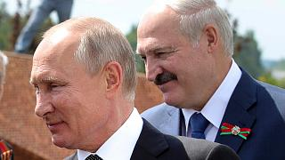 In this June 30, 2020, file photo, Russian President Vladimir Putin, left, and Belarusian President Alexander Lukashenko greet World War II veterans.