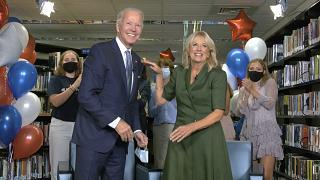In this image from video, Democratic presidential candidate former Vice President Joe Biden, his wife Jill Biden, celebrate after the roll call vote at the DNC.