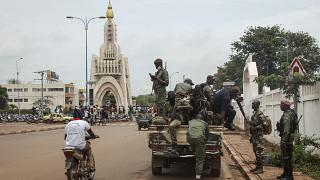 Security forces were pictured riding on trucks through the capital city, Bamako, on Tuesday.